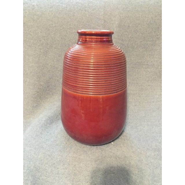This gorgeous burnt sienna Italian vase features etched lines on the upper half, and a smooth and clear lower half. Made...