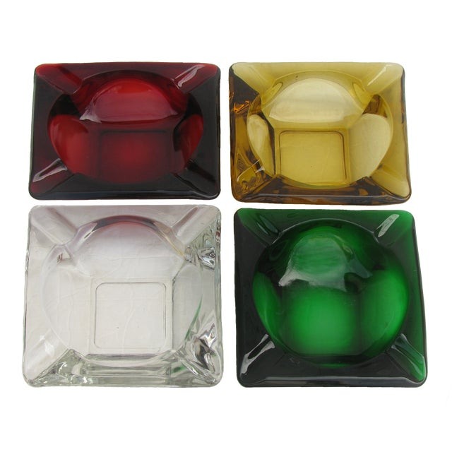 Set of four large, sculptural MCM art glass ashtrays. Their strong geometric styling offers great graphic appeal. and the...