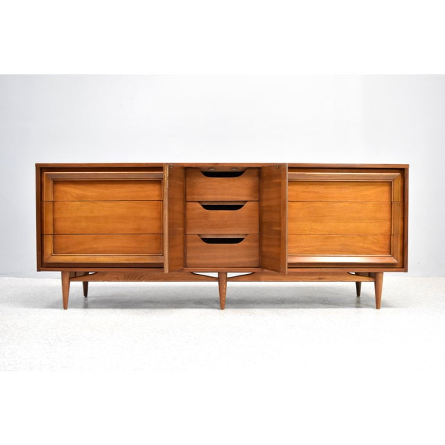 Stunning, over-sized mid century modern triple dresser/credenza in walnut by Basic Witz, C1960s. This timeless storage...