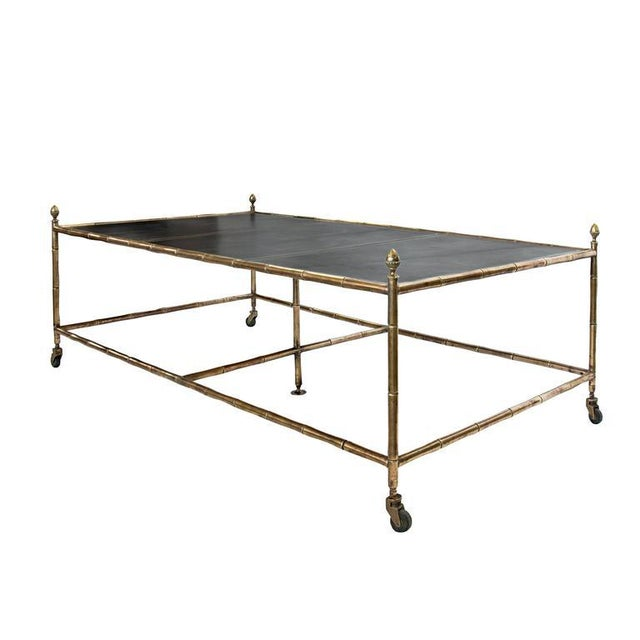 An Oversized Very Rare Jansen Brass and Leather Coffee Table on Faux Bamboo Brass Base with three-section tooled leather top.