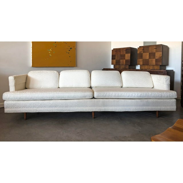 A gorgeous, increasingly rare 9' long Edward Wormley for Dunbar sofa with walnut legs. This sofa was model #4907 and two...