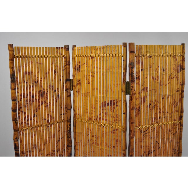 """Item features wrapped wood frame, 3 panels, brass hinges, great style and form. Circa Late 20th Century. Measurements: 72""""..."""