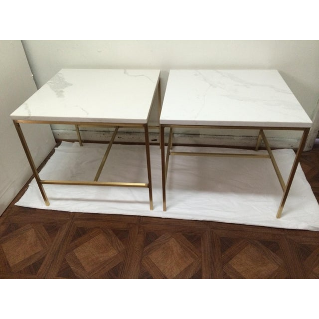 Very beautiful and elegant Paul McCobb side tables. Made of brass tube frames and gorgeous white glass tops. Great condition.