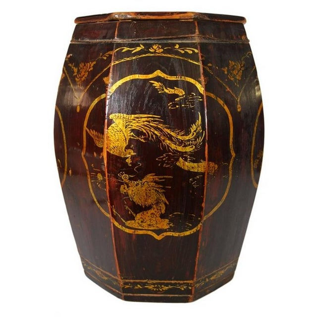 A 19th century grain storage barrel with medallions, hand-painted in, China. This octagonal barrel was made with dark...