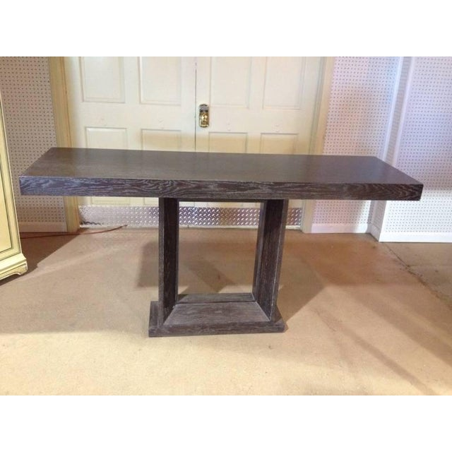 Cerused oak console table with a painted finish. Nice open square base.