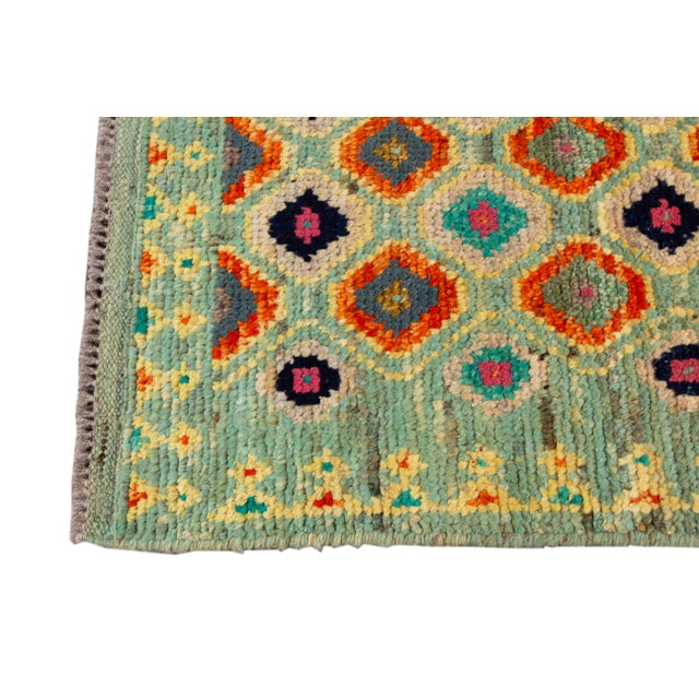 A hand-knotted modern Gabbeh rug with an allover geometric design. This piece has great detailing and colors. It would be...