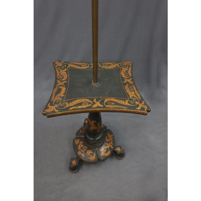 Floor lamp and table in one. The edges are decorated in gold color leaves, which are also featured on the bottom tripod...