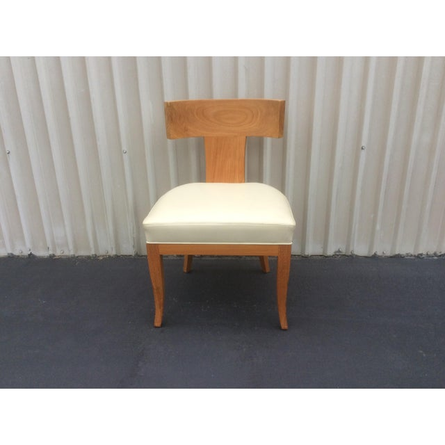 Great looking light colored leather chair by ironies. Seven or eight of these are available. They can be used as dining...