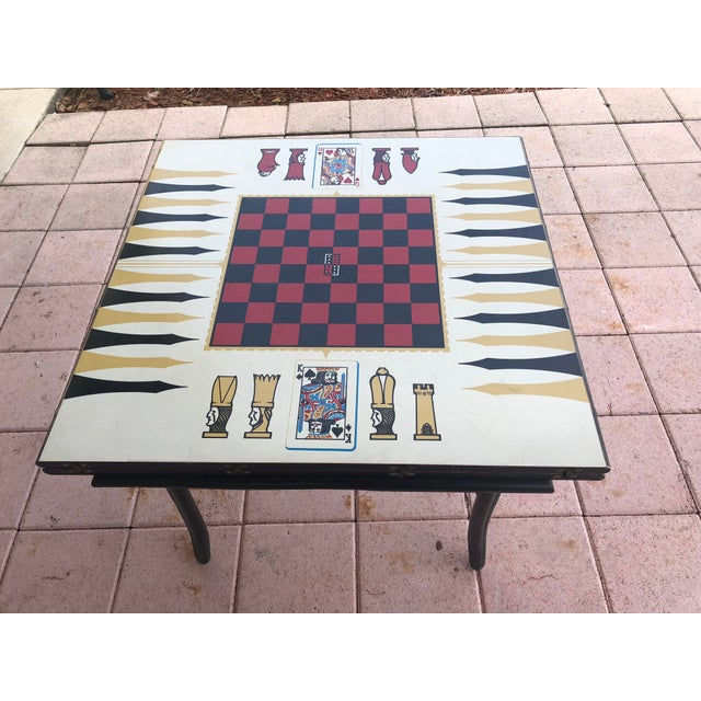 This is a rare and unique table from the 1950s. The formica top game table slides open to reveal a hidden compartment. Top...