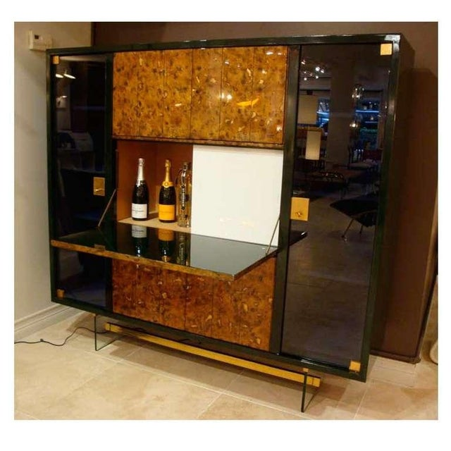 Very rare and important drop front libraire cabinet featuring a body in original two tone deep green lacquer which is...