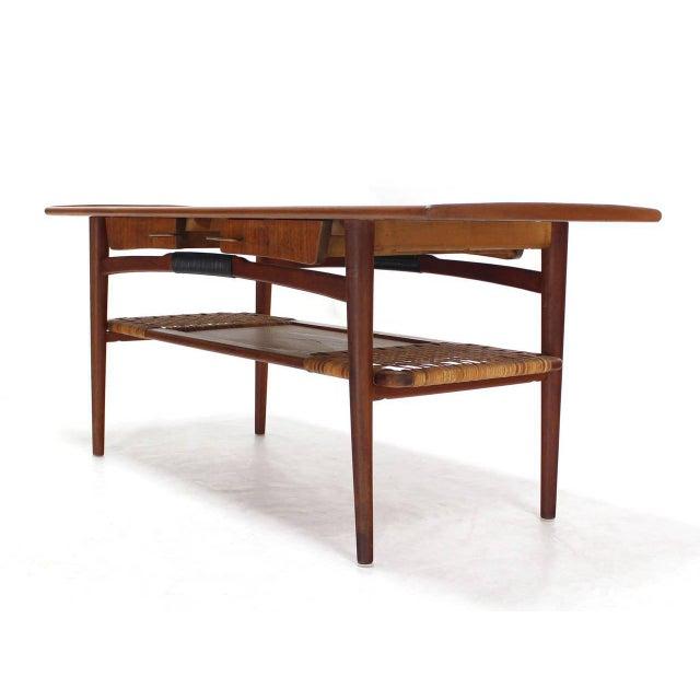 Danish Modern Danish Modern Teak Coffee Table Cane Shelf Rolled Edges 4 Storage Drawers For Sale - Image 3 of 9