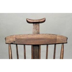 American Country (19th Cent) stained pine arm chair with spindle back and adjustable headrest