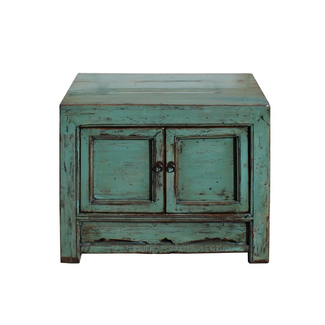 This is a handmade Chinese oriental end table nightstand with two doors. The surface is finished with distressed aqua...