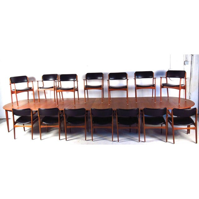 This truly unique set includes a matching set of 14 Eric Buck dining chairs paired with a truly spectacular conference...