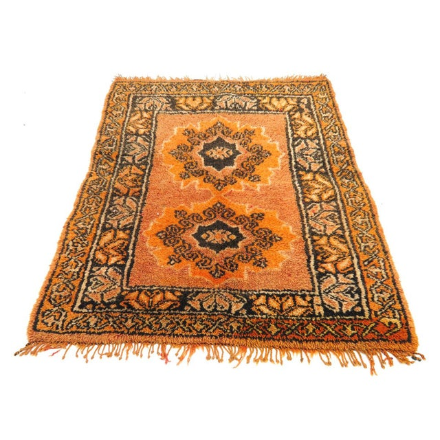 Vintage Taznakht rug handwoven with saffron, brown, and ivory wool in a Berber medallion design and decorative border.