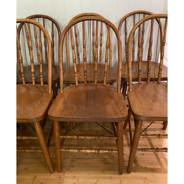 Set of 10 bow back Windsor style chairs by Marietta Chair Company in Ohio. These chairs date to the early 1900's. Made of...