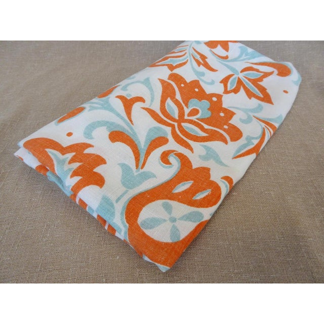 Vintage linen tablecloth in a stencil -style print in orange and turquoise on white background - very good condition - one...