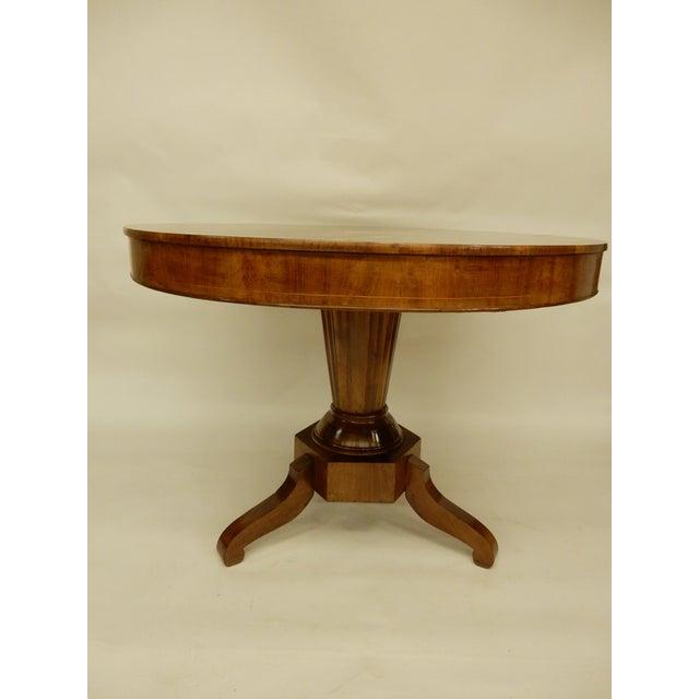 Round walnut 19th century Northern European center hall table. Very nice inlaid star and line inlay.