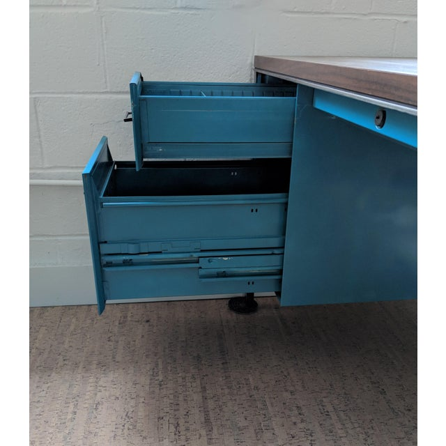 A great historical desk with stunning craftsmanship. This Steelcase tanker desk has been refinished in a high-gloss teal....
