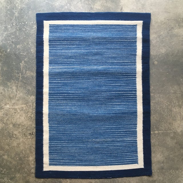 New production- Indigo hand dyed flat weave woven wool rug from Oaxaca. Beautiful blue and ivory color way in excellent...