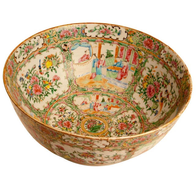 A wonderful large scale Chinese Roe Medallion punch bowl decorated in the inside and outside with people and lowers.