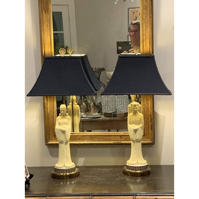 """Stunning pair of Asian porcelain male and female """"figure"""" lamps with gold lined pagoda style black silk shades with brass..."""
