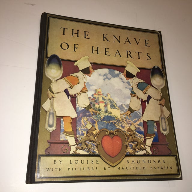 A beautiful first edition book The knave Of Hearts by Louise Saunders with fabulous illustrations by Maxfield Parrish....