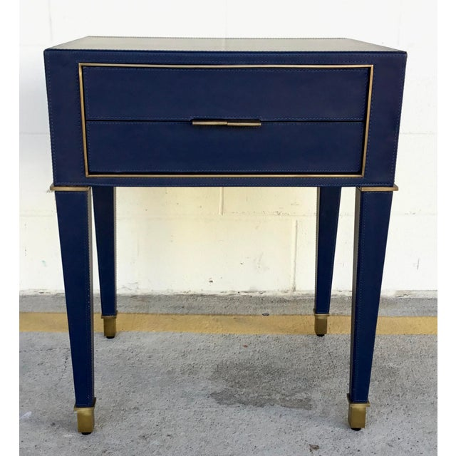 Original retail $2592, Bungalow 5 modern navy blue leather and antique brass finish hunter two drawer side table, showroom...