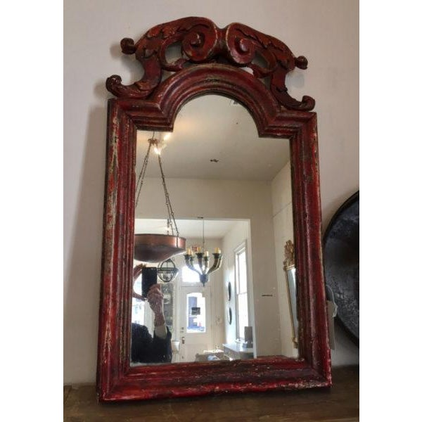 19th c. Italian Mirror with carved, gessoed, and red-painted frame. Condition: Commensurate with age Some repairs at the...