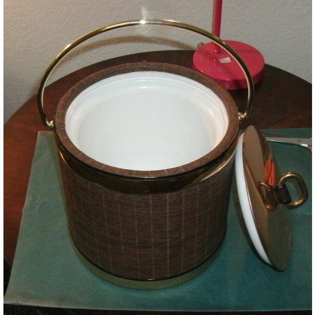 Funtastic vintage ice bucket by Kraftware. Padded vinyl covering made to look like wood grain panels and brassy handle,...