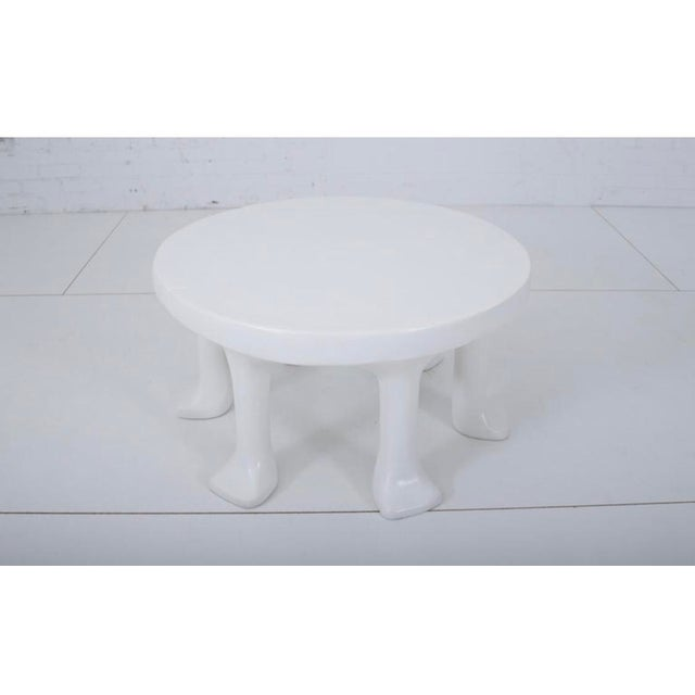 John Dickinson African leg coffee table. Round table with 6 primitive animal paw legs. Very heavy. Cast of glass fiber...