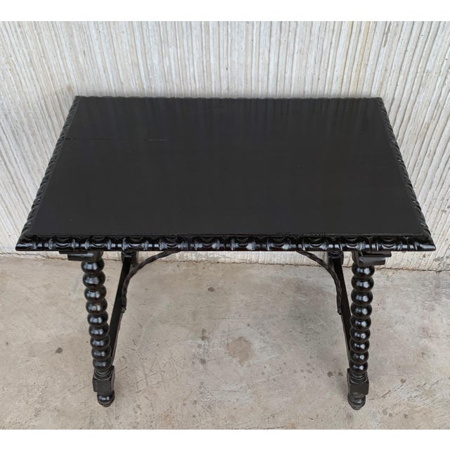 About 19th Spanish Baroque Side Table with Iron Stretcher and Carved Top in Walnut Details OF THE PERIOD Baroque PLACE OF...