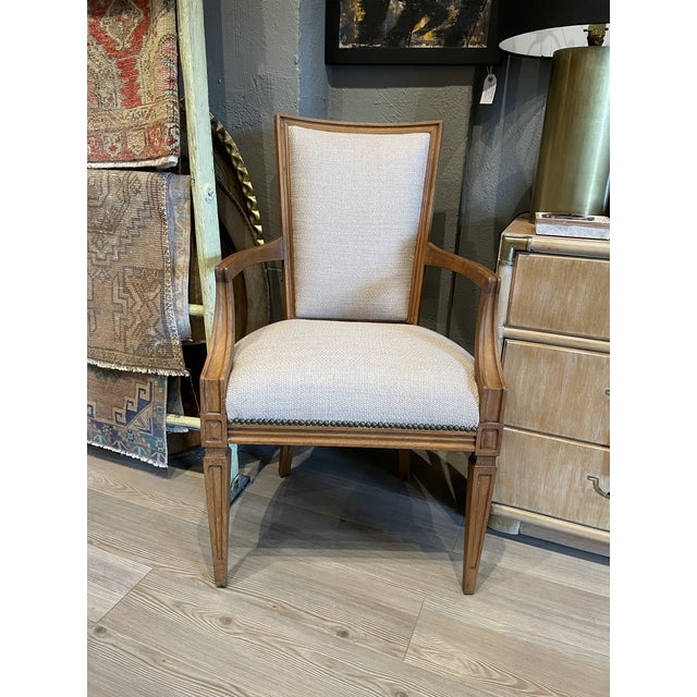 Traditional dining chairs with chunky linen upholstery. Only 2 of the 8 chairs have arms. Gorgeous around any table for a...