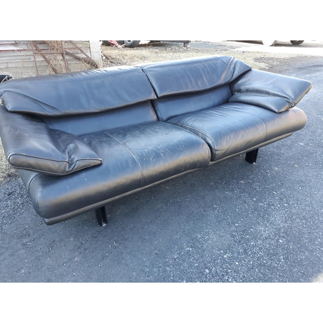 This is a vintage B & B Itlai sofa in black leather. It is the Alanda model designed by Paolo Piva. The sofa is in very...
