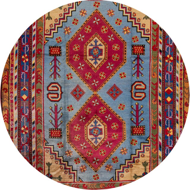 A beautiful Vintage hand-knotted Kothan rug with a blue field, and multicolor accents in an all-over geometric design....