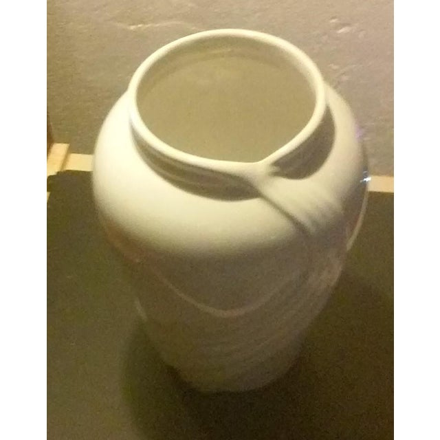 Really nice porcelain table vase in excellent condition and being free from any chips,crack,or flaws. White in color and...