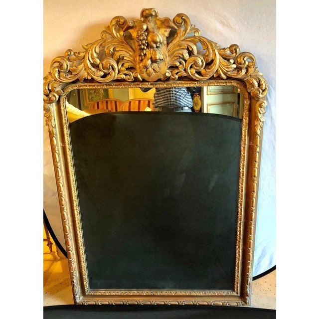 A Large Turn of the Century Carved Rococo Wall Or Console Mirror w. Grape and Scroll Design. This finely carved console,...