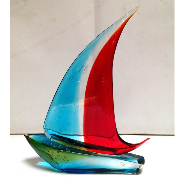 Italian vintage single sail boat hand blown and crafted in red, blue, and yellow Murano glass by Sergio Constantini,...