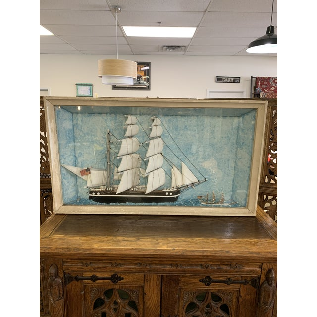 A rare find! Vintage shadow box diorama of a sail boat art piece with an imperfection... Over time the sail has dropped...