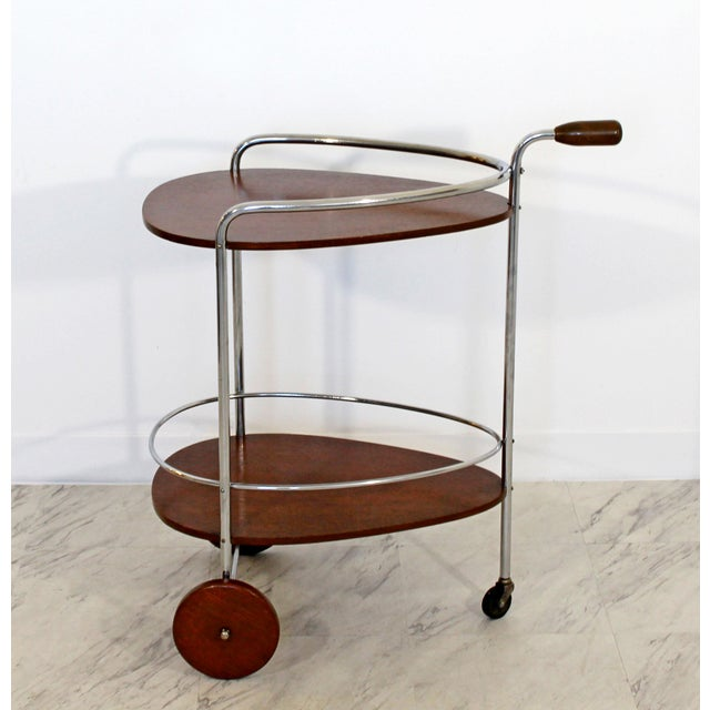 For your consideration is a phenomenal, two tiered bar or serving cart, made of wood and chrome, by Treitel Gratz, circa...