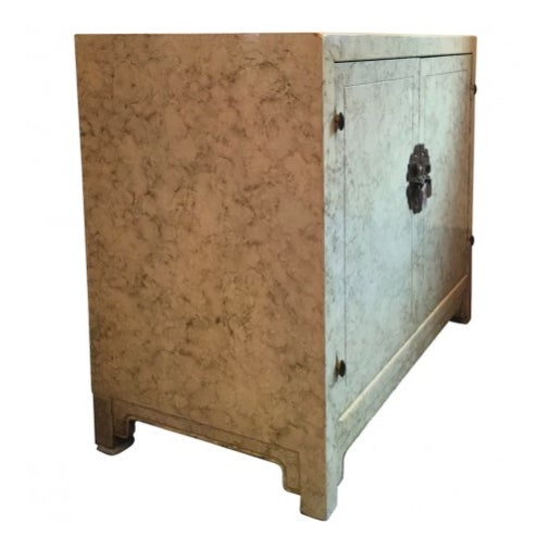 Vintage Henredon faux tortoiseshell cabinet. Solid brass hardware. This piece has plenty of storage and would look great...