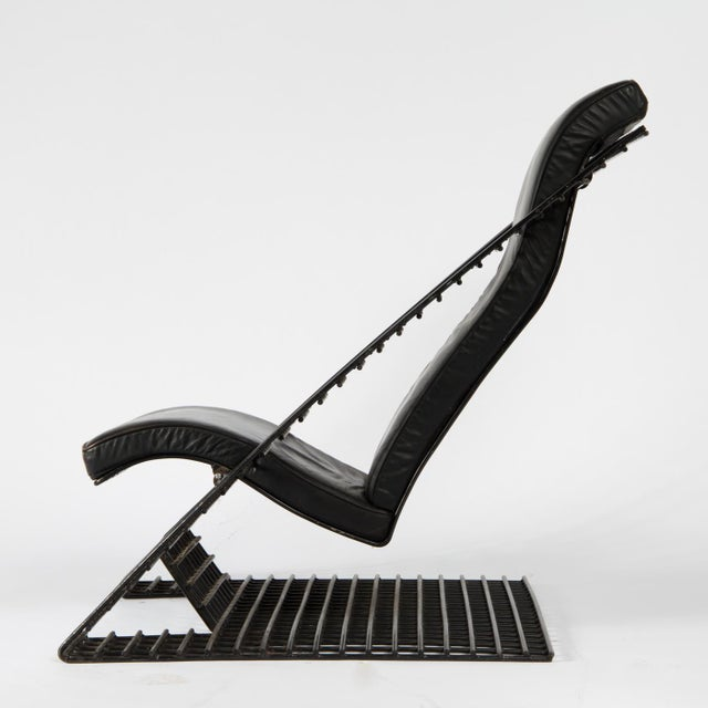 1980s postmodern wire cantilever lounge chair with ottoman. Freely swinging design in black lacquered steel wire, black...