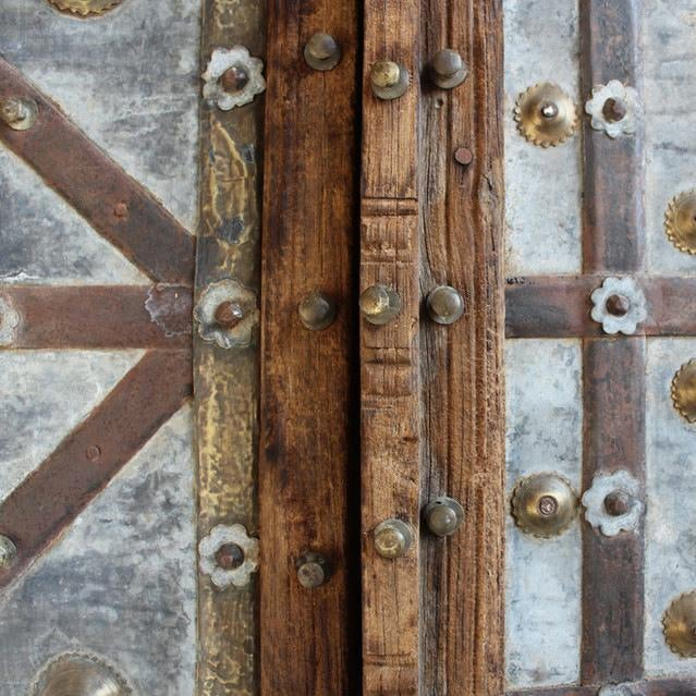 Original metal work Indian door from Rajasthan. Arched top Mogul design with beautiful iron strap details, brass...