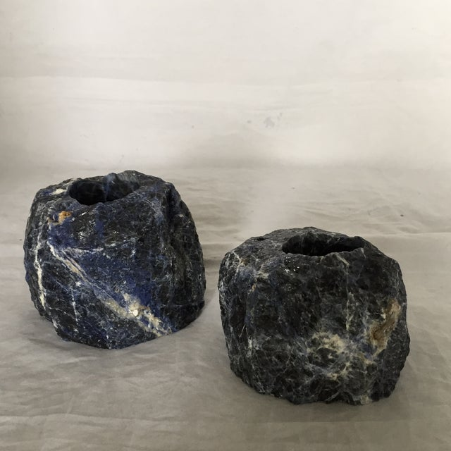 Pair of raw (natural) cut blue sodalite stone votive candleholders. Lined on bottom to prevent surface scratches/slipping....