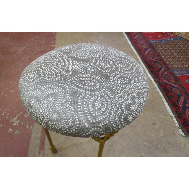4 gilt twisted rope legs with tassels at the bottom. Newly reupholstered in a taupe and white paisley pattern. Perfect for...