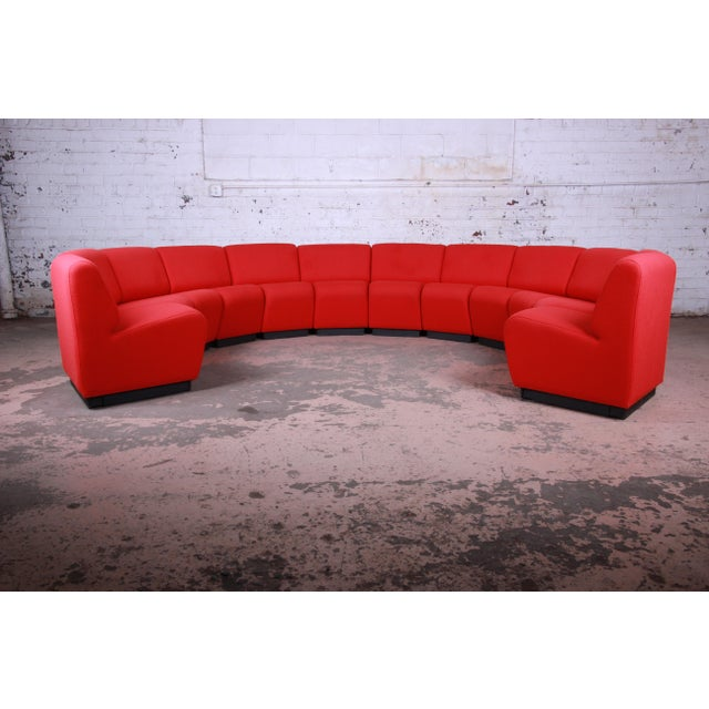 Offering a rare and monumental 12-piece modular sectional sofa designed by John Mascheroni for Vecta. The Tappo sofa...