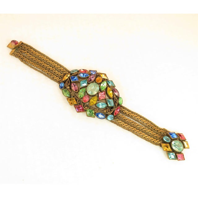 Offered here is a Czech Art Deco gold-washed bracelet with jewel-tone Bohemian crystals and chains from the 1920s. The...