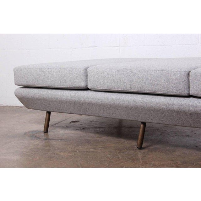 A bench / daybed with brass legs. Designed by Marco Zanuso for Arflex. Fully restored and upholstered in Maharam wool....