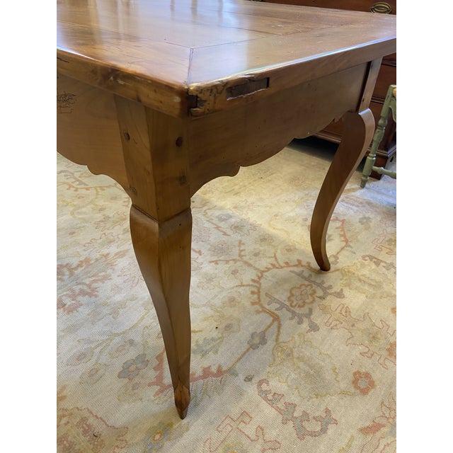 This is an absolutely beautiful farm table. It is french style with cabriole legs. The cherry wood is in beautiful...