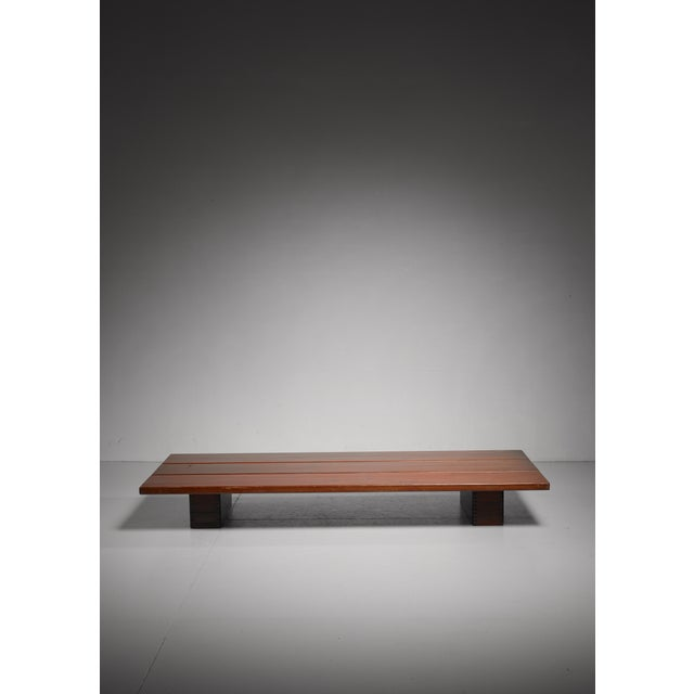 A rare piece by Ilmari Tapiovaara for Laukaan Puu in dark stained pine. It can be used as a bench, a lengthy side table or...